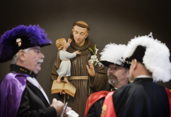 Members of the Knights of Columbus stand in front of the statue of Saint Anthony of Padua at St. Anthony of Padua Roman Catholic Church, 6350 N. Fort  Apache Road, on Friday, Feb. 5, 2016. The chu ...