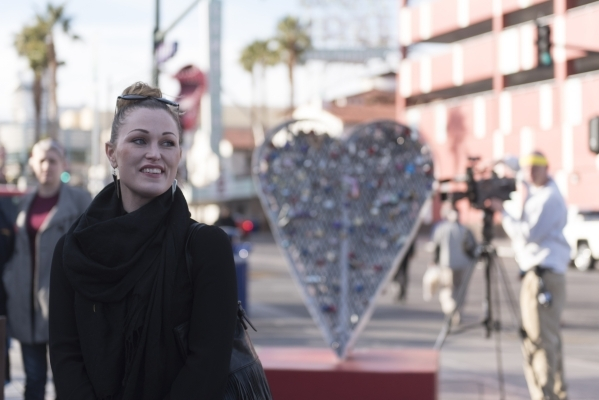 Nova May, artist of the Love Locket, speaks to the crowd in front of her sculpture which was vandalized last month at Downtown Container Park at 707 Fremont St. in Las Vegas Thursday, Feb. 4, 2016 ...