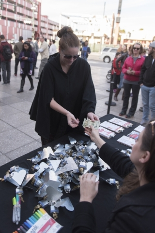 Robyn Friedman purchases six locks to be added to Nova May's sculpture which was vandalized last month at Downtown Container Park at 707 Fremont St. in Las Vegas Thursday, Feb. 4, 2016. Prof ...