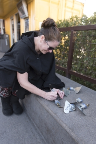 Robyn Friedman writes on the six locks she purchased to add to Nova May's sculpture which was vandalized last month at Downtown Container Park at 707 Fremont St. in Las Vegas Thursday, Feb.  ...