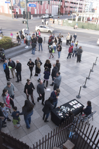 A crowd gathers around Nova May's Love Locket  to add new locks to the sculpture which was vandalized last month at Downtown Container Park at 707 Fremont St. in Las Vegas Thursday, Feb. 4,  ...