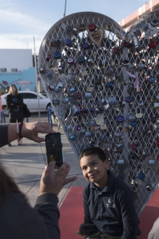 Six-year-old Julian Martinez poses for a photo after adding his lock to Nova May's sculpture which was vandalized last month at Downtown Container Park at 707 Fremont St. in Las Vegas Thursd ...