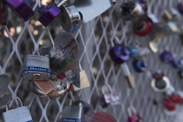 A newly added lock with a Denver Broncos theme is seen on Nova May's Love Locket sculpture which was vandalized last month at Downtown Container Park at 707 Fremont St. in Las Vegas Thursday ...