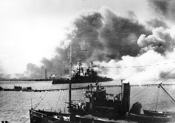 HISTORIC -- The USS Nevada (BB-36) steams down the shipping channel after being damaged by intense dive bomb attacks in Pearl Harbor Sunday, Dec. 7, 1941, carried out during a surprise attack by a ...