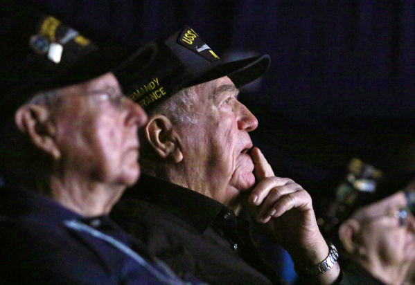 """U.S. Navy veterans that were stationed on the USS Nevada Cliff Burks, center, and Ansel Tupper, left, watch the documentary """"Battleship NevadaÓ at South Point hotel-casino Monday, Feb. 8,  ..."""
