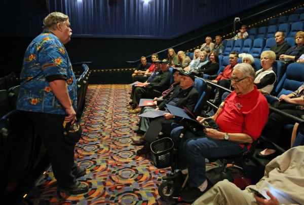 """Chuck Pride, left, speaks to a private audience that are there to watch his documentary """"Battleship Nevada"""" at South Point hotel-casino Monday, Feb. 8, 2016, in Las Vegas. U.S. Navy vete ..."""