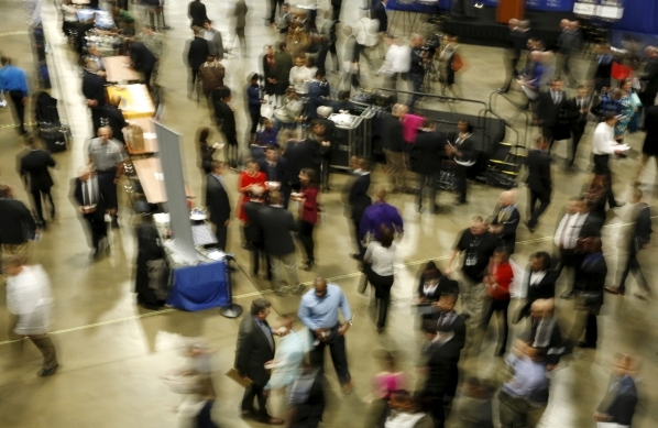 """Job seekers break out to visit corporate employment personnel at a U.S. Chamber of Commerce Foundation """"Hiring Our Heroes"""" military job fair in Washington January 8, 2016. (Gary Cameron/ ..."""