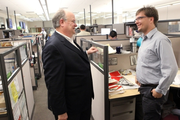 Las Vegas Review-Journal Editor J. Keith Moyer, left, visit with reporter Ben Botkin in the Review-Journal newsroom in Las Vegas after being introduced as editor Friday, Feb. 5, 2016. K.M. Cannon/ ...