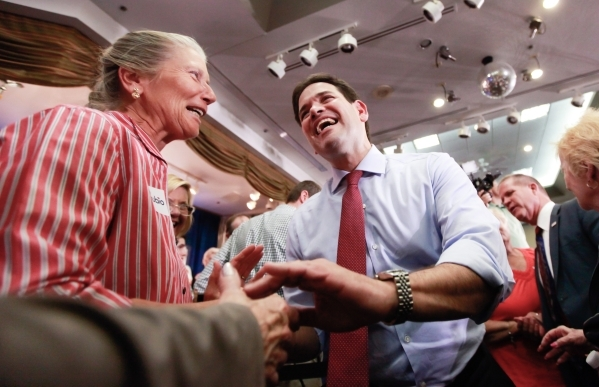 U.S. Sen. Marco Rubio, R-Fla., greets supporters after speaking at a rally at Mountain Shadows Community Center in the Sun City area of Summerlin in Las Vegas on Thursday, Oct. 8, 2015. Chase Stev ...