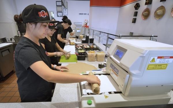 Aira Aldaba uses a þÄúsushi robotþÄù to finish rolling a sushi roll at Soho SushiBurrito at 2600 W. Sahara Ave. in Las Vegas on Saturday, Feb. 6, 2016. Bill Hughes/Las Vegas Revi ...