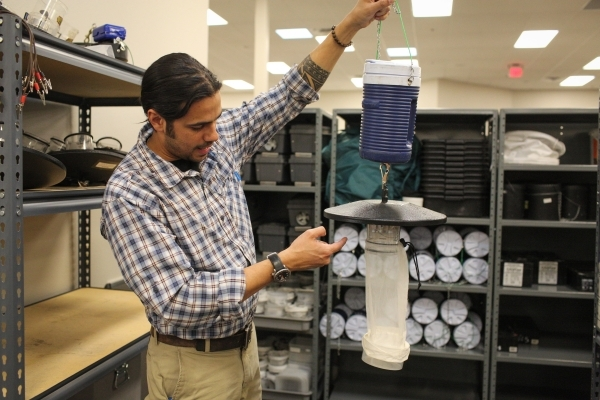 Environmental Health Supervisor Vivek Raman holds a mosquito trap at the Southern Nevada Health District which traps 26,000 mosquitos a year to send for testing at the SNHD in Las Vegas on Friday, ...