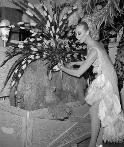 A Jubilee showgirl poses with a costume and storage crate Tuesday, Sept. 16, 1980, at the MGM Grand. Courtesy, Gary Angel/Las Vegas News Bureau