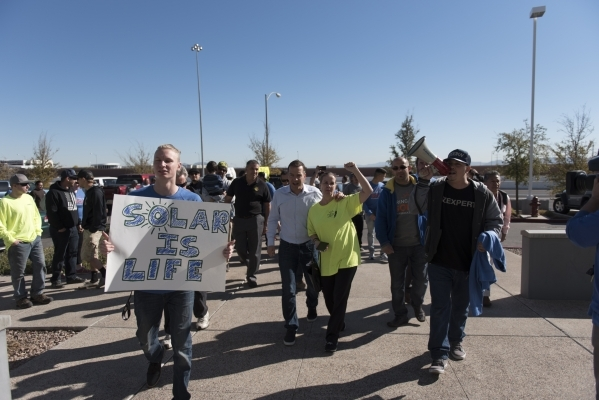 Solar workers and supporters prepare to march into the Public Utilities Commission office during a hearing at 9075 W. Diablo Dr. in Las Vegas Monday, Feb. 8, 2016. The protesters brought three whe ...