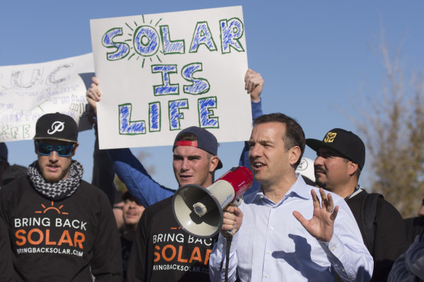 SolarCity Senior Vice President Marco Krapels, second from right, speaks to solar workers and supporters  protesting outside of the Public Utilities Commission office at 9075 W. Diablo Dr. in Las  ...
