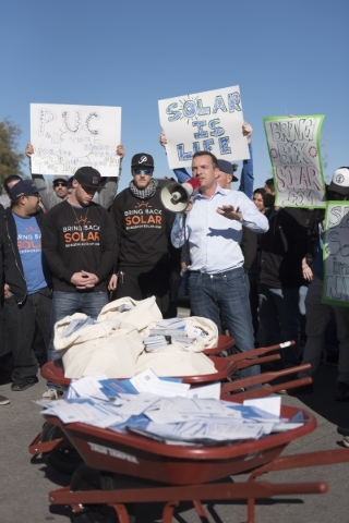 SolarCity Senior Vice President Marco Krapels, center, speaks to solar workers and supporters protesting outside of the Public Utilities Commission office at 9075 W. Diablo Dr. in Las Vegas Monday ...