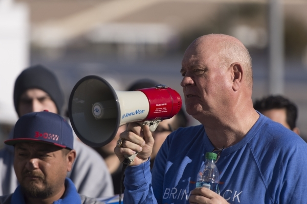 SolarCity warehouse worker Mike Collian, right, speaks to solar workers and supporters protesting outside of the Public Utilities Commission office at 9075 W. Diablo Dr. in Las Vegas Monday, Feb.  ...