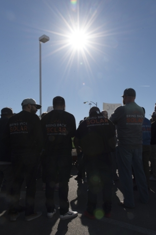 Solar workers and supporters protest outside of the Public Utilities Commission office at 9075 W. Diablo Dr. in Las Vegas Monday, Feb. 8, 2016. The protesters brought three wheelbarrows filled wit ...