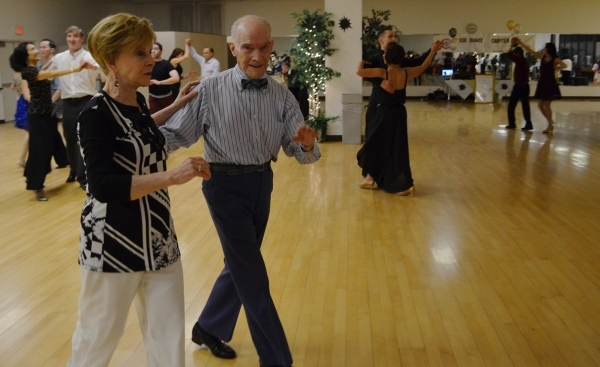 John Sholl and Rita Maroun take a turn around the floor at USA Dance's Las Vegas Chapter's 10th anniversary Jan. 23, 2016, at the Charleston Heights Arts Center. The group's next ...