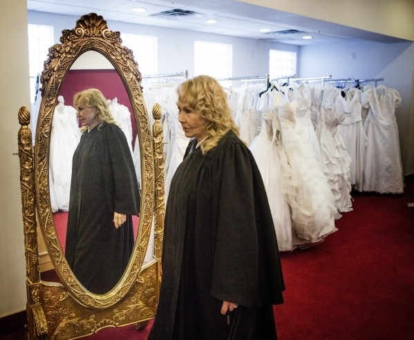 Charolette Richards, owner of A Little White Wedding Chapel, 1301 Las Vegas South Boulevard, stands in the bridal gown room on Monday, Feb. 8, 2016. For over 60 years Richards has officiated the w ...