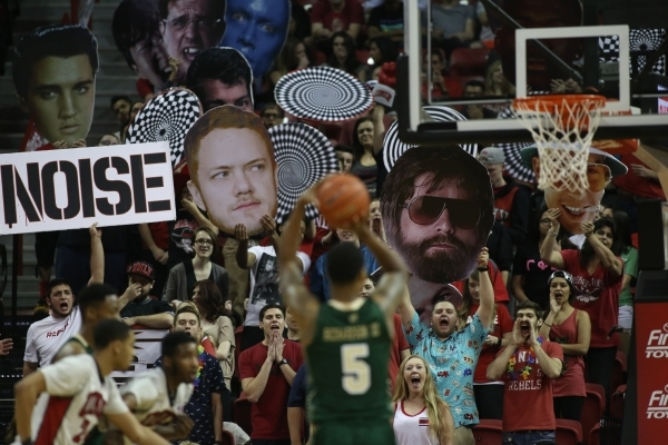 UNLV Rebels fans try to distract Colorado State Rams guard Fred Richardson III (5) as he takes a free throw during a game against Colorado State at the Thomas & Mack Center in Las Vegas on Sat ...