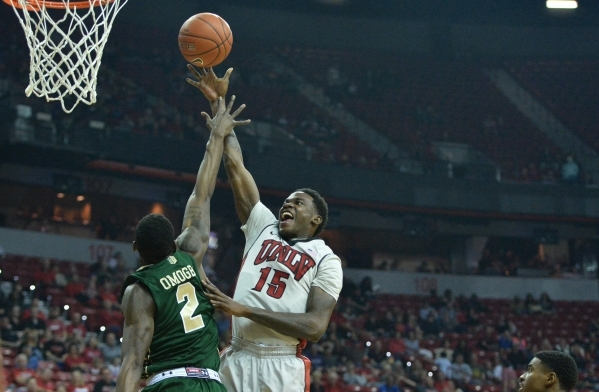 UNLV Rebels forward Dwayne Morgan (15) shoots the ball over Colorado State Rams forward Emmanuel Omogbo (2) during a game against Colorado State at the Thomas & Mack Center in Las Vegas on Sat ...