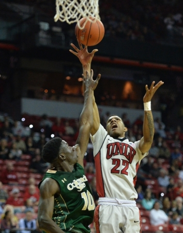 UNLV Rebels guard Patrick McCaw (22) shoots the ball over Colorado State Rams guard Joe De Ciman (10) during a game against Colorado State at the Thomas & Mack Center in Las Vegas on Saturday, ...