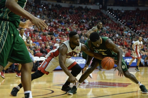 UNLV Rebels guard Ike Nwamu (34) steals a loose ball away from Colorado State Rams guard Joe De Ciman (10) during a game against Colorado State at the Thomas & Mack Center in Las Vegas on Satu ...