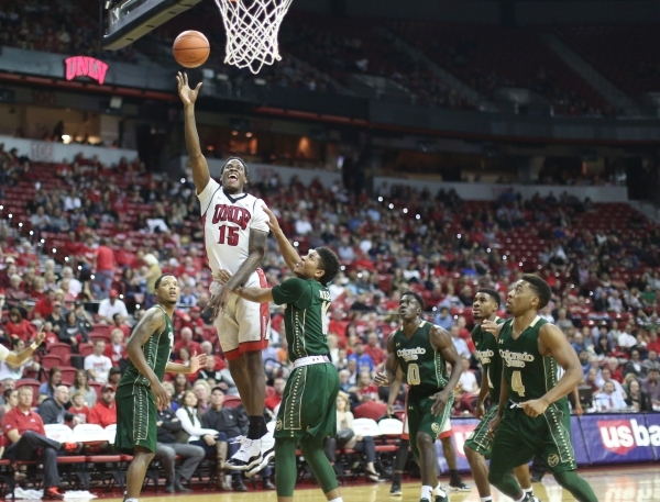 UNLV Rebels forward Dwayne Morgan (15) shoots the ball over the Colorado State Rams defense during a game against Colorado State at the Thomas & Mack Center in Las Vegas on Saturday, Feb. 13,  ...