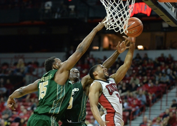 UNLV Rebels guard Jerome Seagears (2) shoots the ball under Colorado State Rams defenders during a game against Colorado State at the Thomas & Mack Center in Las Vegas on Saturday, Feb. 13, 20 ...