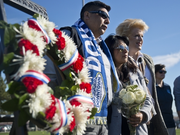 Jose Hernandez, left, and Beatrice Gonzalez, the parents of Nohemi Gonzalez, a college student killed in the recent terrorist attacks in Paris, stand with Las Vegas Mayor Carolyn Goodman during op ...