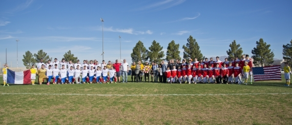 The Sagebrush Soccer Club United Red 98 from Reno, right, and Team LA 59-62 from France stand during opening ceremonies for the Las Vegas MayorþÄôs Cup International Showcase at the Betty ...