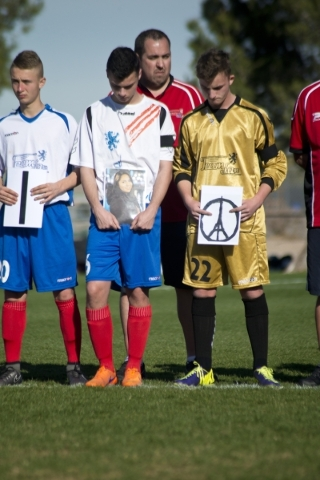 Team LA 59-62 from France holds signs honoring Nohemi Gonzalez, who was killed in the recent terrorist attacks in Paris, on the field during opening ceremonies for the Las Vegas MayorþÄôs ...