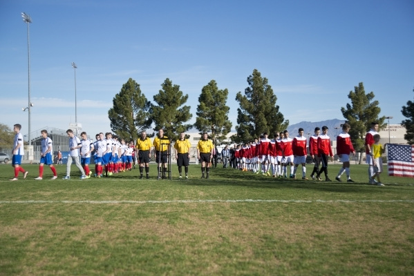 The Sagebrush Soccer Club United Red 98 from Reno, right, and Team LA 59-62 from France walk onto the field during opening ceremonies for the Las Vegas MayorþÄôs Cup International Showcas ...
