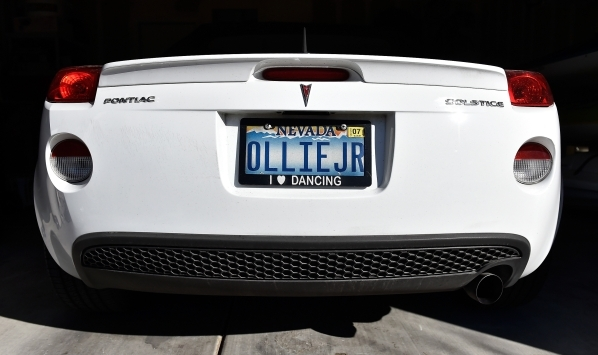 The license plate of Oliver Phillips' sports car is displayed at his Henderson home Tuesday, Feb. 9, 2016. Phillips, 85, died in January from injuries from a beating in his home by a paid es ...