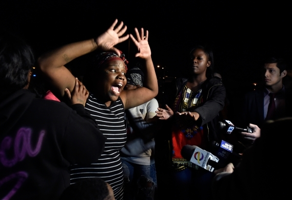 Vickie Davis gestures as she speaks with the media during a candlelight vigil along Thomas Avenue Monday, Feb. 8, 2016, in North Las Vegas. Davis' daughter, 2-year-old Evelyn Green, was kill ...