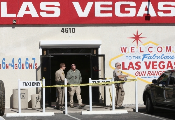 Las Vegas police investigate a shooting at the Las Vegas Gun Range on Blue Diamond Road on February 9, 2016. The person was taken to University Medical Center with a gunshot wound to the head. Biz ...