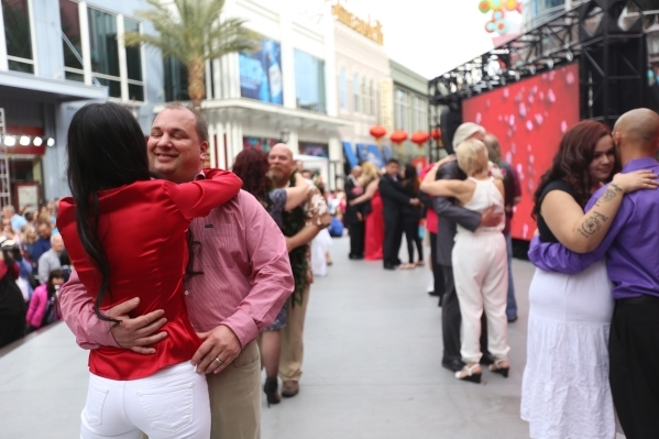 Jason Cardinal hugs his newlywed wife Susan Cardinal as they dance with other newlyweds after a public ceremony on the Linq Promenade Sunday, Feb. 14, 2016 in Las Vegas. Rachel Aston/Las Vegas Rev ...