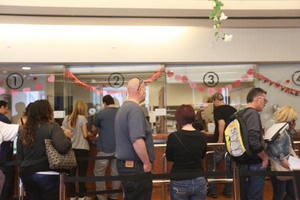 Couples wait in line at the Las Vegas Clerk's Office to obtain marriage licenses Sunday, Feb. 14, 2016. Rachel Aston/Las Vegas Review-Journal Follow @rookie__rae