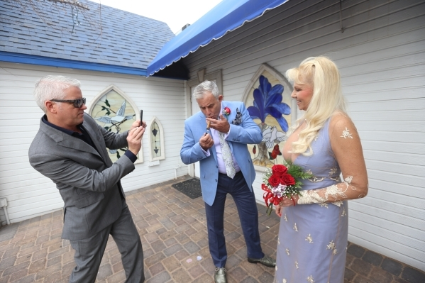 Mark Lacey takes a photo of his friends Andrew and Cheryl Cambridge after they renewed their vows at the Graceland Wedding Chapel in Las Vegas, Sunday, Feb. 14, 2016. Rachel Aston/Las Vegas Review ...