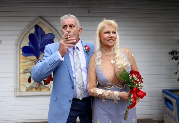 andrew cambridge and his wife cheryl cambridge share a cigar after they renewed their vows at - Valentines Day Las Vegas