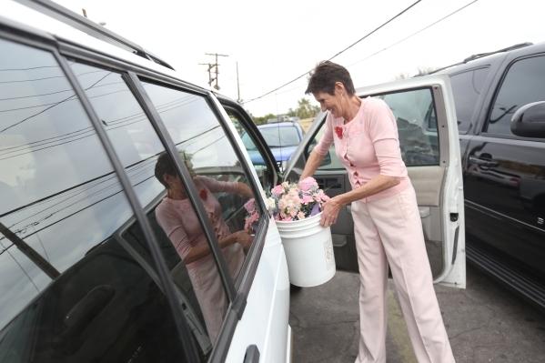 Grace Vargas, a floral designer, places a bucket of flowers in her car at the Graceland Wedding Chapel in Las Vegas, Sunday, Feb. 14, 2016. Rachel Aston/Las Vegas Review-Journal Follow @rookie__rae