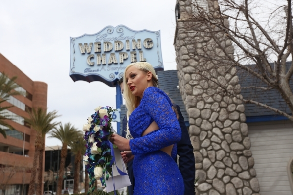 Anna Dubova stands in front of her new husband Denis Emelyanov at the Graceland Wedding Chapel in Las Vegas, Sunday, Feb. 14, 2016. Rachel Aston/Las Vegas Review-Journal Follow @rookie__rae