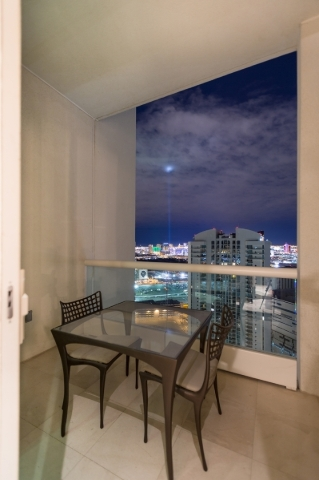 A patio area off the kitchen allows for dining with views of the Strip. COURTESY