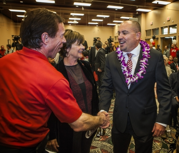 Rich Abajian, general manager at Finlay Toyota left, greets new UNLV's Men's football coach Tony Sanchez  during press conference,Thursday, Dec. 11,2014, at Stan Fulton Building. In th ...