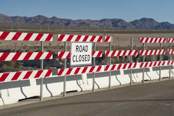 Road signs mark the end of North 5th Street at the northeast end of the 215 beltway on Saturday, Dec. 12, 2015. Much of the land beyond the signs is planned to be developed into The Villages at Tu ...