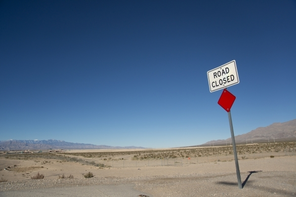 A road sign marks the end of Losee Road at the northeast end of the 215 beltway on Saturday, Dec. 12, 2015. Much of the land beyond the sign is planned to be developed into The Villages at Tule Sp ...