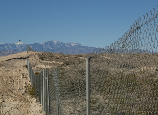 A gate at the end of North 5th Street at the northeast end of the 215 beltway on Saturday, Dec. 12, 2015. Much of the land beyond the gate is planned to be developed into The Villages at Tule Spri ...