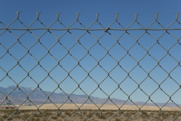 A gate at end of Losee Road at the northeast end of the 215 beltway on Saturday, Dec. 12, 2015. Much of the land beyond the gate is planned to be developed into The Villages at Tule Springs, a mas ...