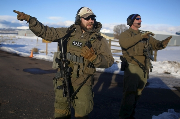 FBI agents talk as they man the entry to the Burns Municipal Airport in Burns, Oregon January 30, 2016.  REUTERS/Jim Urquhart