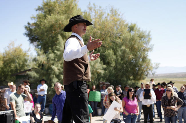 "Ryan Bundy, son of Cliven Bundy, speaks during a rally near Bunkerville Nev. Monday, April 7, 2014, 2014. The Bureau of Land Management has begun to round up what they call ""trespass cattle&q ..."
